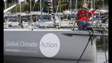 Greta Thunberg looks up as she poses for a picture on the boat Malizia as it is moored in Plymouth, England Tuesday, Aug. 13, 2019. Greta Thunberg, the 16-year-old climate change activist who has inspired student protests around the world, is heading to the United States this week - in a sailboat. (AP Photo/Kirsty Wigglesworth)