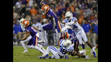 """FILE - In this Nov. 17, 2018, file photo, Clemson's Derion Kendrick (10) hurdles Duke's Chris Rumph ll (96) on a kickoff return as Jarrett Garner reaches for him during the first half of an NCAA college football game in Clemson, S.C. Sure, Clemson lost all four of its """"Power Rangers"""" defensive line and seven starters on defense from its title team. But the Tigers' offense, led by Heisman Trophy candidates quarterback Trevor Lawrence and tailback Travis Etienne, looks ready to operate at an even higher level than a year ago when it averaged 527 yards and 44.3 points a game. (AP Photo/Richard Shiro, File)"""