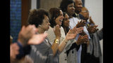 Democratic presidential candidate Sen. Kamala Harris, D-Calif., center, attends a Corinthian Baptist Church service, Sunday, Aug. 11, 2019, in Des Moines, Iowa. (AP Photo/John Locher)
