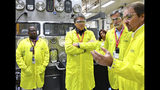 FILE - In this May 10, 2017, file photo provided by the Los Alamos National Laboratory, U.S. Secretary of Energy Rick Perry, second from left, accompanied by Laboratory Director Charlie McMillan, second from right, learns about capabilities at the Los Alamos Laboratory Plutonium Facility, from Jeff Yarbrough, right, Los Alamos Associate Director for Plutonium Science and Manufacturing, in Los Alamos. A federal appeals court has ruled against Nevada in a legal battle over the U.S. government's secret shipment of weapons-grade plutonium to a site near Las Vegas. A three-judge panel of the 9th U.S. Circuit Court of Appeals on Tuesday, Aug. 13, 2019, denied the state's appeal after a judge refused to block any future shipments to Nevada. The court in San Francisco says the matter is moot because the Energy Department already sent the radioactive material and has promised that no more will be hauled there. (Los Alamos National Laboratory via AP, File)