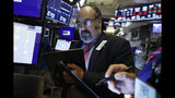 Trader John Porcelli works on the floor of the New York Stock Exchange, Tuesday, Aug. 13, 2019. Stocks shook off an early stumble and edged higher on Wall Street led by gains in technology and health care companies. (AP Photo/Richard Drew)