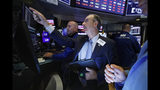Trader Joe Dente, center, and specialist Mark Fitzgerald work on the floor of the New York Stock Exchange, Tuesday, Aug. 13, 2019. Stocks shook off an early stumble and edged higher on Wall Street led by gains in technology and health care companies. (AP Photo/Richard Drew)