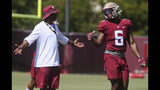 Florida State head coach Willie Taggart, left, talks to tight end Tré McKitty (6) during an NCAA college football preseason practice Sunday, Aug. 4, 2019, in Tallahassee, Fla. (AP Photo/Phil Sears)