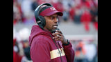 """FILE - In this Saturday, Nov. 3, 2018 file photo, Florida State head coach Willie Taggart confers on his headset during the first half of an NCAA college football game against North Carolina State in Raleigh, N.C. James Blackman has the confidence of a starting quarterback and with good reason, he was Florida State's starter in 2017. But Blackman acknowledges he's in an open QB competition with Wisconsin transfer Alex Hornibrook and others. """"We're going to grade these guys every day on what we ask them to do and see if these guys can take information from the meeting room to the field, and who can run our offense and do it efficiently and do it to where we're not being careless with the football,"""" Taggart said. (AP Photo/Chris Seward, File)"""