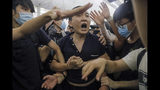 Protesters detaiN a man, who protesters claimed was a Chinese undercover agent during a demonstration at the Airport in Hong Kong, Tuesday, Aug. 13, 2019. Riot police clashed with pro-democracy protesters at Hong Kong's airport late Tuesday night, a chaotic end to a second day of demonstrations that caused mass flight cancellations at the Chinese city's busy transport hub. (AP Photo/Vincent Yu)
