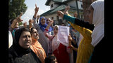 Kashmiri Muslim women shout slogans during a protest after Eid prayers in Srinagar, Indian controlled Kashmir, Monday, Aug. 12, 2019. Troops in India-administered Kashmir allowed some Muslims to walk to local mosques alone or in pairs to pray for the Eid al-Adha festival on Monday during an unprecedented security lockdown that still forced most people in the disputed region to stay indoors on the Islamic holy day. (AP Photo/ Dar Yasin)