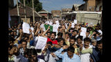 Kashmiri Muslims shout slogans during a protest after Eid prayers in Srinagar, Indian controlled Kashmir, Monday, Aug. 12, 2019. Troops in India-administered Kashmir allowed some Muslims to walk to local mosques alone or in pairs to pray for the Eid al-Adha festival on Monday during an unprecedented security lockdown that still forced most people in the disputed region to stay indoors on the Islamic holy day. (AP Photo/ Dar Yasin)