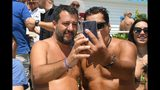 """Italian Deputy Prime Minister and Interior Minister, Matteo Salvini, left, poses for a picture with a supporter during a political rally as part of his 'Italian summer tour', in Taormina, Southern Italy, Sunday, Aug. 11, 2019. Italy on Friday edged closer to holding an election as early as this fall that could move the country farther to the right, with anti-migrant Deputy Premier Matteo Salvini already unofficially campaigning for the premiership and declaring it makes """"no sense"""" to keep alive the feuding populist coalition government. (Carmelo imbesi/ANSA via AP)"""