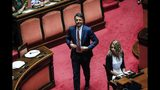 Former Italian premier Matteo Renzi arrives for a session at the Senate in Rome, Tuesday, Aug. 13, 2019. Italy's political leaders were scrambling to line up allies and alliances Tuesday as Matteo Salvini pressed his demands for early elections as soon as possible in the hope of snagging the premiership with his anti-migrant, Euro-skeptic agenda. Hastily summoned back from a vacation break, the Senate was convened to vote later Tuesday on when to schedule a no-confidence motion lodged by Salvini's right-wing League party against Premier Giuseppe Conte's 14-month old populist government. (Giuseppe Lami/ANSA via AP)