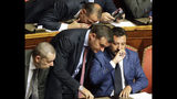 Italian Interior Minister and Deputy-Premier Matteo Salvini, right, sits beside Agricultural Minister and The League's lawmaker Gian Marco Centinaio as he addresses the Senate in Rome, Tuesday, Aug. 13, 2019. Italy's political leaders scrambled to line up allies and form alliances Tuesday as the country's right-wing interior minister pressed his demands for an early election in the hope of snagging the premiership as a platform for his anti-migrant, euroskeptic agenda. Senators hastily summoned back from a vacation break convened for a vote on scheduling their consideration of a no-confidence motion lodged by Matteo Salvini's League party against Premier Giuseppe Conte's 14-month-old populist government. (AP Photo/Alberto Pellaschiar)