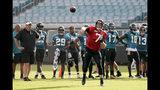 Jacksonville Jaguars quarterback Nick Foles (7) throws a pass as head coach Doug Marrone, far left, looks on during an NFL football practice at the teams stadium, Friday, Aug. 2, 2019, in Jacksonville, Fla. (AP Photo/John Raoux)