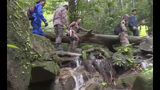 In this image from a video, rescuers conduct a search and rescue operation for a missing British girl at a forest in Seremban, Malaysia Monday, Aug. 12, 2019. A Malaysian shaman joined police from Ireland, France and the U.K. on Monday in the search for a 15 -year-old London girl who mysteriously vanished from a nature resort eight days ago, as her parents offered a cash reward and appealed for information. (AP Photo)