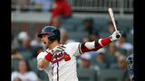 Atlanta Braves third baseman Josh Donaldson (20) drives in a run with a base hit in the first inning of a baseball game against the New York Mets Tuesday, Aug. 13, 2019, in Atlanta. (AP Photo/John Bazemore)