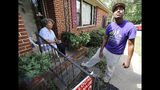 "FILE - In this Saturday, Sept. 10, 2016 file photo, Rodney Smith Jr., founder of Raising Men Lawn Care Service, looks skyward while talking with homeowner Irene Renee Jolly in Huntsville, Ala. Smith Jr., who traveled to all 50 states to mow lawns for free says he's traveling across the country again to bring together police officers and the community. Rodney Smith Jr. tweeted Monday, August 12, 2019 to announce his tour called ""Mowing with Cops"" will start Wednesday August 14 in Apopka, Florida. (AP Photo/Jay Reeves, File)"