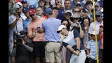 Rory McIlroy, of Northern Ireland, chips from the edge of the third hole green in the final round of the Northern Trust golf tournament at Liberty National Golf Course, Sunday, Aug. 11, 2019, in Jersey City, N.J. (AP Photo/Mark Lennihan)