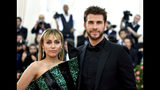 "FILE - In this May 6, 2019 file photo, Miley Cyrus, left, and Liam Hemsworth attend The Metropolitan Museum of Art's Costume Institute benefit gala celebrating the opening of the ""Camp: Notes on Fashion"" exhibition in New York. Cyrus and Hemsworth have separated after less than a year of marriage. A representative for the singer said Saturday, Aug. 10 the pair decided a break was best while they focus on ""themselves and careers."" Cyrus and Hemsworth, who starred in ""The Hunger Games"" films, have been an on-and-off again couple for more than a decade. They married in December 2018. (Photo by Charles Sykes/Invision/AP, File)"