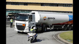 Police escorts a fuel truck leaving a fuel depot in Aveiras, outside Lisbon, Monday, Aug. 12, 2019. Portugal is rationing gas as a precaution after some 2,000 tanker truck drivers began an open-ended strike over pay on Monday. The government has set a limit of 25 liters (6.6 gallons) for customers at gas stations until further notice. (AP Photo/Armando Franca)