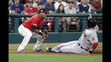 Boston Red Sox's J.D. Martinez slides safely into third base as Cleveland Indians' Jose Ramirez, left, bobbles the ball during the fifth inning of a baseball game Tuesday, Aug. 13, 2019, in Cleveland. (AP Photo/Tony Dejak)