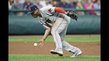Boston Red Sox's Rafael Devers barehands a ball hit by Cleveland Indians' Oscar Mercado during the seventh inning in a baseball game, Tuesday, Aug. 13, 2019, in Cleveland. Mercado was safe at first base. (AP Photo/Tony Dejak)