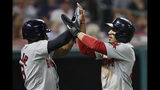 Boston Red Sox's Mookie Betts, right, and Boston Red Sox's Jackie Bradley Jr. celebrate after scoring on a double by Rafael Devers during the sixth inning of the team's baseball game against the Cleveland Indians, Tuesday, Aug. 13, 2019, in Cleveland. (AP Photo/Tony Dejak)