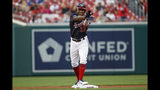 Washington Nationals' Victor Robles celebrates his double during the first inning of the team's baseball game against the Cincinnati Reds at Nationals Park, Tuesday, Aug. 13, 2019, in Washington. (AP Photo/Alex Brandon)