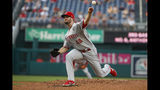 Cincinnati Reds starting pitcher Alex Wood throws during the first inning of the team's baseball game against the Washington Nationals at Nationals Park, Tuesday, Aug. 13, 2019, in Washington. (AP Photo/Alex Brandon)