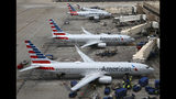 FILE - This July 17, 2019, file photo shows American Airlines planes at Phoenix Sky Harbor International Airport in Phoenix. American Airlines wants two labor unions to pay damages and the company's attorney fees, saying they ignored a judge's order to quickly end a work slowdown by mechanics. (AP Photo/Ross D. Franklin, File)