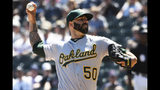 Oakland Athletics starting pitcher Mike Fiers (50) throws the ball against the Chicago White Sox during the first inning of a baseball game, Friday, Aug. 9, 2019, in Chicago. (AP Photo/David Banks)