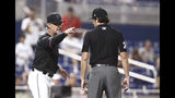 Miami Marlins manager Don Mattingly yells towards umpire John Tumpane after a balk call was made on Miami Marlins starting pitcher Caleb Smith during the fifth inning of the team's baseball game against the Atlanta Braves on Friday, Aug. 9, 2019, in Miami. Mattingly was thrown out of the game. (AP Photo/Brynn Anderson)