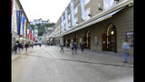 Out side view of the opera house , right, in Salzburg, Austria, Wednesday, Aug. 14, 2019 where singer Placido Domingo will perfom 'Luisa Miller' by Giuseppe Verdi. Numerous women have told The Associated Press that celebrated opera superstar Placido Domingo tried to pressure them into sexual relationships by dangling jobs and sometimes punishing them when they refused his advances. (AP Photo/Kerstin Joensson)