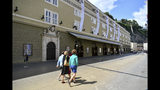 Out side view of the opera house in Salzburg, Austria, Wednesday, Aug. 14, 2019 where singer Placido Domingo will perfom 'Luisa Miller' by Giuseppe Verdi. Numerous women have told The Associated Press that celebrated opera superstar Placido Domingo tried to pressure them into sexual relationships by dangling jobs and sometimes punishing them when they refused his advances. (AP Photo/Kerstin Joensson)