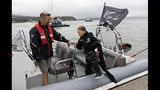 Climate change activist Greta Thunberg enters a dinghy to board the Malizia II boat in Plymouth, England, Wednesday, Aug. 14, 2019. The 16-year-old climate change activist who has inspired student protests around the world will leave Plymouth, England, bound for New York in a high-tech but low-comfort sailboat.(AP Photo/Kirsty Wigglesworth, pool)