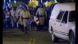 The casket of slain CHP officer Andre Moye is transported to a hearse from the Riverside University Health Systems Medical Center after he was shot and killed while two fellow officers were wounded during a traffic stop on Eastridge Avenue overpass over the 215 Freeway in Riverside in Moreno Valley, Calif., on Monday, Aug 12, 2019. (Terry Pierson/The Orange County Register via AP)