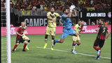 Atlanta United goalkeeper Alec Kann blocks a shot by Club America in front of Bruno Valdez during the first half of a Campeones Cup soccer match Wednesday, Aug. 14, 2019, in Atlanta. (Curtis ComptonAtlanta Journal-Constitution via AP)