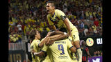 Club America celebrates a goal in the first half of the Campeones Cup soccer match against Atlanta United on Wednesday, Aug. 14, 2019, in Atlanta. (AP Photo/John Bazemore)