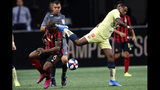 Atlanta United midfielder Darlington Nagbe (6) has the ball kicked away by Club America forward Roger Martinez during the first half of a Campeones Cup soccer match Wednesday, Aug. 14, 2019, in Atlanta. (AP Photo/John Bazemore)