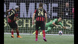 Atlanta United forward Josef Martinez has his penalty kick blocked by Club America goalkeeper Oscar Jimenez as Julian Gressel watches during the first half of a Campeones Cup soccer match Wednesday, Aug. 14, 2019, in Atlanta. (Curtis ComptonAtlanta Journal-Constitution via AP)