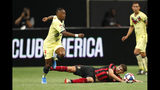 Atlanta United's Emerson Hyndman has the ball kicked away by Club America midfielder Renato Ibarra, left, during the first half of a Campeones Cup soccer match Wednesday, Aug. 14, 2019, in Atlanta. (AP Photo/John Bazemore)