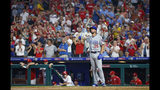 Chicago Cubs' Cole Hamels gets a standing ovation from the fans during the third inning of the team's baseball game against the Philadelphia Phillies, Wednesday, Aug. 14, 2019, in Philadelphia. (AP Photo/Chris Szagola)
