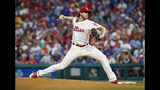 Philadelphia Phillies starting pitcher Aaron Nola throws during the second inning of the team's baseball game against the Chicago Cubs, Wednesday, Aug. 14, 2019, in Philadelphia. (AP Photo/Chris Szagola)