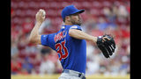 Chicago Cubs starting pitcher Cole Hamels throws during the first inning of the team's baseball game against the Cincinnati Reds, Thursday, Aug. 8, 2019, in Cincinnati. (AP Photo/John Minchillo)