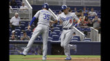 Los Angeles Dodgers' Corey Seager (5) is met by Cody Bellinger (35) after hitting a two-run home run during the first inning of the team's baseball game against the Miami Marlins, Wednesday, Aug. 14, 2019, in Miami. (AP Photo/Lynne Sladky)