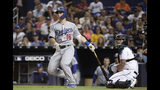 Los Angeles Dodgers' Will Smith watches his solo home run during the fourth inning of the team's baseball game against the Miami Marlins, Tuesday, Aug. 13, 2019, in Miami. At right is Marlins catcher Jorge Alfaro. (AP Photo/Lynne Sladky)