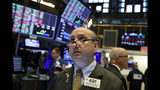 FILE - In this Tuesday, Aug. 13, 2019, file photo trader Andrew Silverman works on the floor of the New York Stock Exchange. The threat of a recession doesn't seem so remote anymore, and stocks sank Wednesday after the bond market threw up one of its last remaining warning flags on the economy's health. (AP Photo/Richard Drew, File)