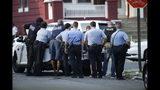 Philadelphia police stage as they respond to an active shooting situation, Wednesday, Aug. 14, 2019, in the Nicetown neighborhood of Philadelphia. (AP Photo/Matt Rourke)