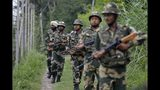 In this Tuesday, Aug. 13, 2019 file photo, India's Border Security Force (BSF) soldiers patrol near the India Pakistan border fencing at Garkhal in Akhnoor, about 35 kilometers (22 miles) west of Jammu, India. Pakistan's prime minister assured Kashmiri people living in the Indian-administered part of the divided region that he supports them in their struggle for self-determination. In his statement Wednesday, Imran Khan condemned New Delhi's decision Aug. 5 to downgrade Kashmir's status, as he began celebrations marking Pakistan's independence day.(AP Photo/Channi Anand)