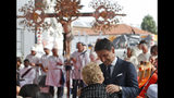 Italian Premier Giuseppe Conte embraces a relative of a victim of the Morandi bridge collapse, during a remembrance ceremony to mark the first anniversary of the tragedy, in Genoa, Italy, Wednesday, Aug. 14, 2019. The Morandi bridge was a road viaduct on the A10 motorway in Genoa, that collapsed one year ago killing 43 people. (AP Photo/Antonio Calanni)
