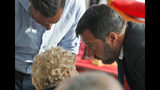 Italian Interior Minister Matteo Salvini greets a relative of a victim of the Morandi bridge collapse, during a remembrance ceremony to mark the first anniversary of the tragedy, in Genoa, Italy, Wednesday, Aug. 14, 2019. The Morandi bridge was a road viaduct on the A10 motorway in Genoa, that collapsed one year ago killing 43 people. (AP Photo/Antonio Calanni)