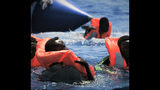 """Migrants at sea are rescued by the Ocean Viking ship, operated by the NGOs Sos Mediterranee and Doctors Without Borders, in the Mediterranean Sea, Tuesday, Aug. 13, 2019. More than 500 rescued migrants are stuck in the Mediterranean on two NGO boats, as Italy and Malta continue to deny them access to their ports. French charity group Doctors Without Borders (MSF) said late Monday in a tweet that it had completed """"a critical rescue"""" of another 105 people onto the Ocean Viking, raising the total number of migrants on board ship to 356. (Hannah Wallace Bowman/MSF/SOS Mediterranee via AP)"""