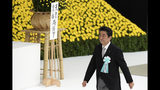 Japanese Prime Minister Shinzo Abe walks to deliver his remarks during a memorial ceremony for the war dead at Nippon Budokan Martial Arts Hall in Tokyo Thursday, Aug. 15, 2019. Japan marked Thursday the 74th anniversary of the end of World War II.(AP Photo/Eugene Hoshiko)